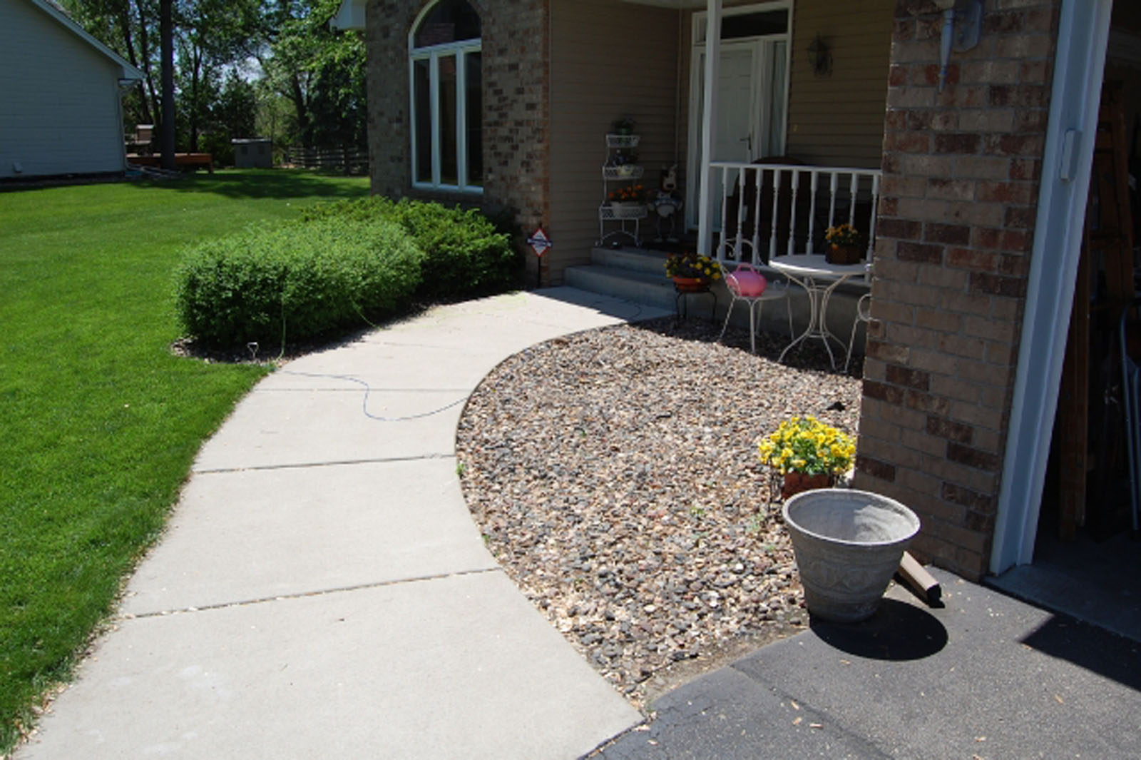 bloomington-front-entrance-patio-before